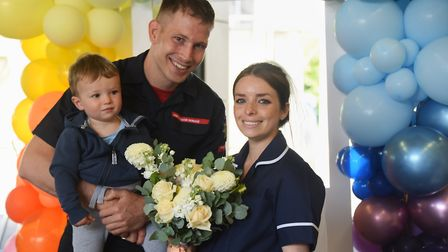 An emotional NHS worker Elysa Varvel, and her fiancé, fire fighter Richard Lovett, with their son, 1