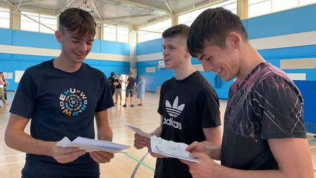 Jack Hill (right) and Jamie Hall (centre) picks up their A-level results at Hellesdon High School. P