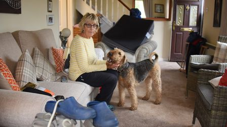 Angeline Connolly in her front room which was flooded after torrential rain in Sheringham. Picture: