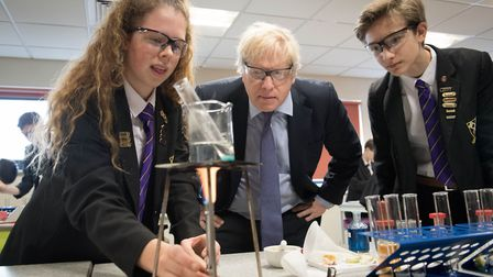 Boris Johnson helps with a science demonstration whilst on the General Election campaign trail. Phot