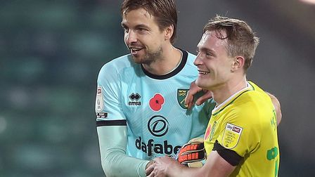 Canaries goalkeeper Tim Krul celebrates victory over Swansea with Ollie Skipp Picture: Paul Chestert