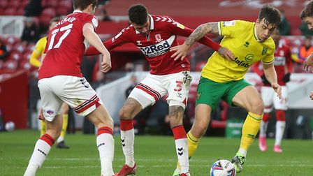 Jordan Hugill of Norwich is surrounded by opposition players during the Sky Bet Championship match a