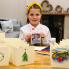 Bethany Mcmanus with some of her Christmas card for Crisis