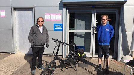 Cllr James Tonkin picking up his bicycle from Borrow a Bike earlier this year.