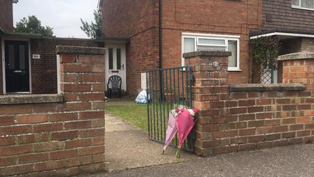 Flowers were left outside the house on Oxford Avenue, Gorleston, after the bodies of Alex Mills and