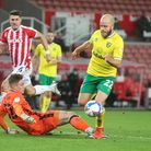 Teemu Pukki of Norwich takes the ball round Josef Bursik of Stoke City and scores his sides 3rd goal