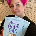 Rachel Mason holding Not the Only One book.
