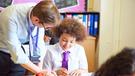 Teacher and pupil in one-to-one mentoring.