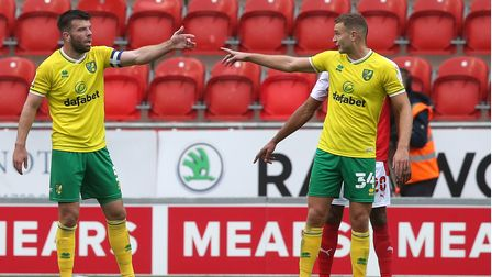 Grant Hanley of Norwich and Ben Gibson of Norwich organise the defence during the Sky Bet Championsh