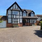 two-storey house with mock-tudor-effect frontage attached garage and paved driveway in front