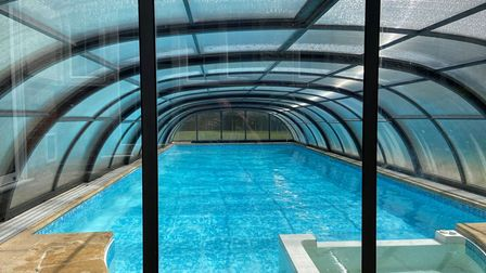 blue garden swimming pool with cover over