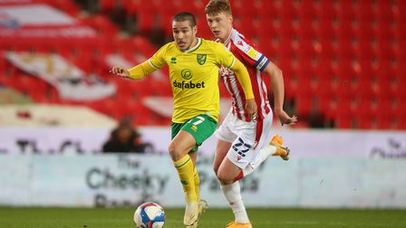 Emiliano Buendia of Norwich and Sam Clucas of Stoke City in action during the Sky Bet Championship m