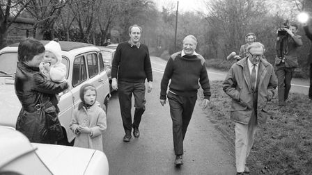 Lord Carrington and then prime minister Edward Heath take a stroll to a country pub during the Febru