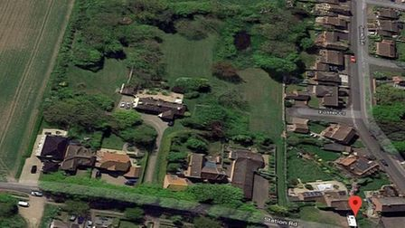 Part of a large garden with planning permission for seven detached houses is up for sale for £1,200,