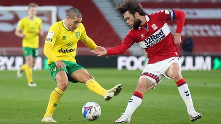 Emiliano Buendia of Norwich and Jonathan Howson of Middlesbrough in action during the Sky Bet Champi