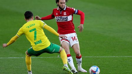 Middlesbrough's Jonny Howson and Norwich City's Lukas Rupp battle for the ball during the Sky Bet Ch