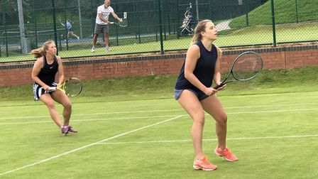 Emily Arbuthnott (left) and Rosie Carr on their way to the women's doubles title at Harpenden Lawn Tennis Club. Picture: HARP...