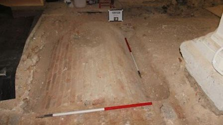 A crypt was uncovered near the font. If the nearby ledger slab and the vault are associated, the remains within the vault...