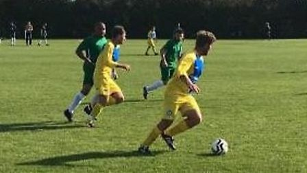 Kieran Butler on the ball for Melbourn in the yellow & blue in their victory over Litlington Athletic. Picture: ANDY EDWARDS
