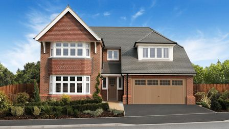 new detached house with gabled left side and attached double garage on right under dormer window