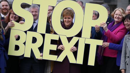 Scottish National Party Westminster leader Ian Blackford (centre left) and Nicola Sturgeon (centre) at the last general...