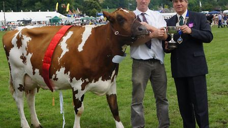 Show president Graham Rudd with champion cattle