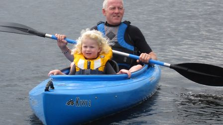 Nick enjoying the outdoor life with his daughter Maddie