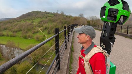 Peak District National Park Ranger with Google Trekker backpack on the Monsal Viaduct, Peak District Photo: PDNPA