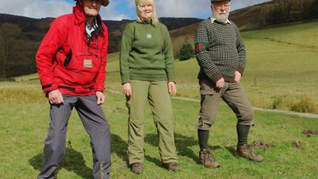 Area ranger Sheila McHale with Gordon Miller (right) and Ian Milne, showing how ranger uniforms have changed since 1954
