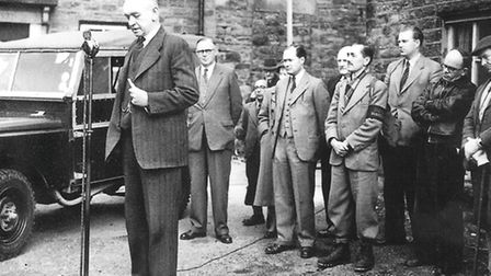 Alderman White, standing on a beer crate, inaugurates the warden service on Good Friday, 1954