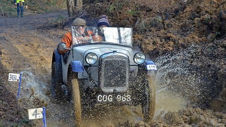 Grant Sellers and Henry Pearson, of Ashover, take the 'Chez Perez' watersplash in their 1936 Austin 7