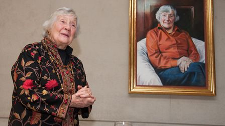 Baroness Williams alongside her portrait in the new Brittain-Williams Room at Somerville College, Oxford Photo: John Cairns
