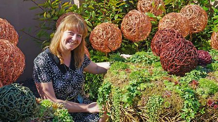 Derbyshire designer and sculptor Rachel Carter with her some of her new designs. The bowl was planted for her Alison...