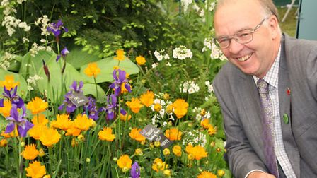 Derbyshire's Robert Hardy beside the Geum 'Totally Tangerine', shortlisted for Plant of the Year. Hardy's stand won a Gold...