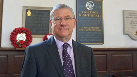 John Rivers, Chairman of the Derby Hospitals NHS Foundation Trust in front of the new plaque to commemorate Florence...
