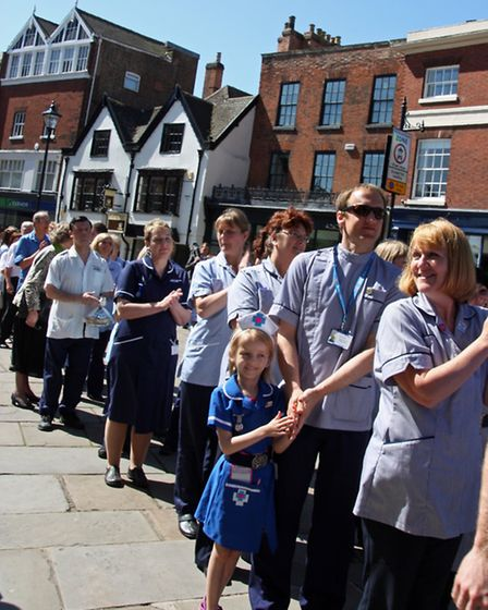The parade of representatives of the nursing profession wait to enter the Cathedral