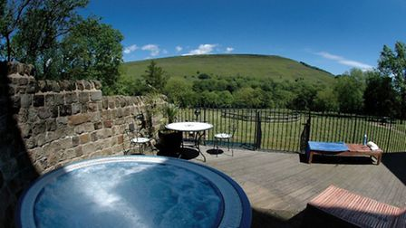 The picturesque hot tub at Losehill House
