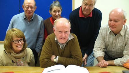 Some of the Chesterfield based research group volunteers looking at VCH Volume III, with County Editor Philip Riden...