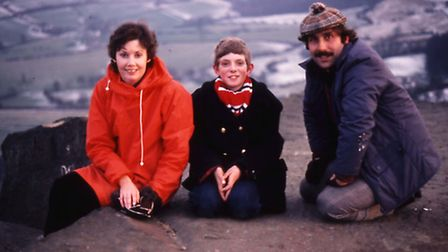 A young Steve (centre) with his parents at his favourite spot on the rocks overlooking his family's farm