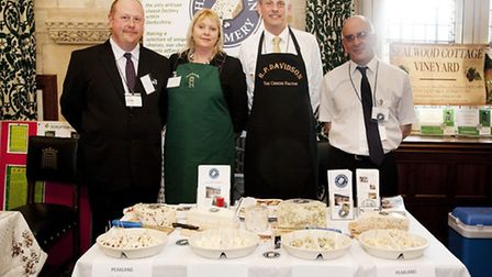 Partners Gary and Claire Milner, Peter Davidson and Alan Salt representing Derbyshire cheese at the Derbyshire Food Day in...
