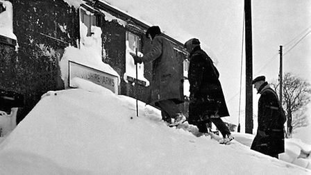 Derbyshire 1947 - climbing the north face of the Devonshire Arms, believed to be the Sparrowpit hostelry since re-named...