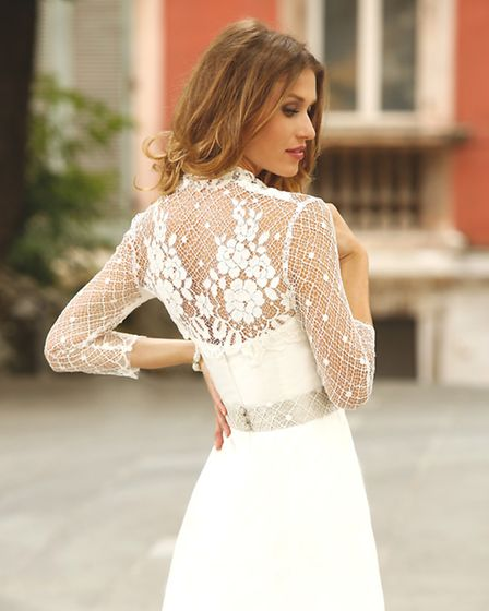Intricate lace detailing and delicate sleeves are a highlight of this design by Linea Raffaelli (www.linearaffaelli.be)