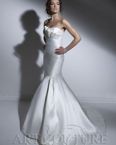 Striking, simple and stylish Art Couture gown from www.artcouturebridal.co.uk