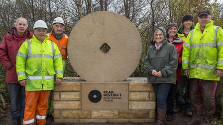 Cllr Sue Perry Smith of Dunford Parish Council (right of millstone) with the team from the National Park and National Grid w...