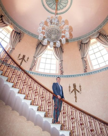 Stuart on the grand staircase that leads from the entrance hall