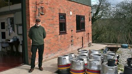Alan Palmer outside the brewery with barrels ready to go