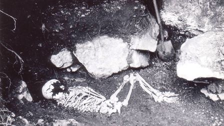 The crouched skeleton laid in front of the as yet unexcavated western cist which can be seen behind it