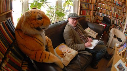 Relaxing in the cafe area: The 'house tiger' makes sure writer Andrew Griffiths pays him the attention he deserves!