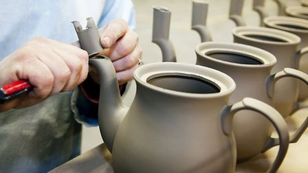 'Fettling' - Putting the final touches to teapots before the first visit to the kiln
