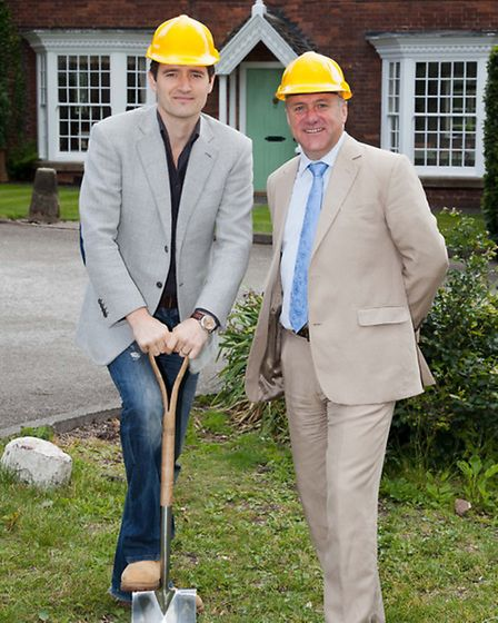 Old Foremarkian actor Tom Chambers cutting the turf for the Quad with Richard Merriman in 2011